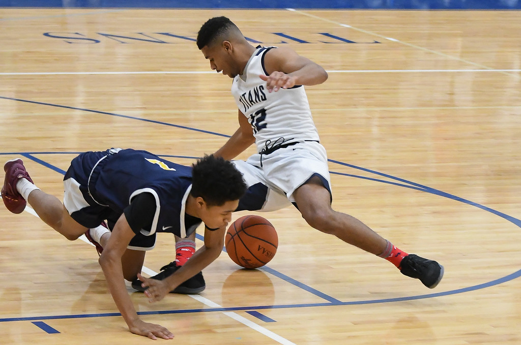 . Eric Bonzar �The Morning Journal Lorain\'s Jalil Little (12) and Warrensville Heights\' Joseph Vallery (1) scramble for a loose ball, Feb. 10, 2017.