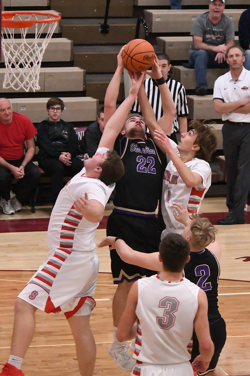 . Eric Bonzar�The Morning Journal<br> Vermilion\'s Ethan Habermehl grabs an offensive rebound over Shelby\'s Nick Amstutz and Cameron Stine (11), March 2, 2018.