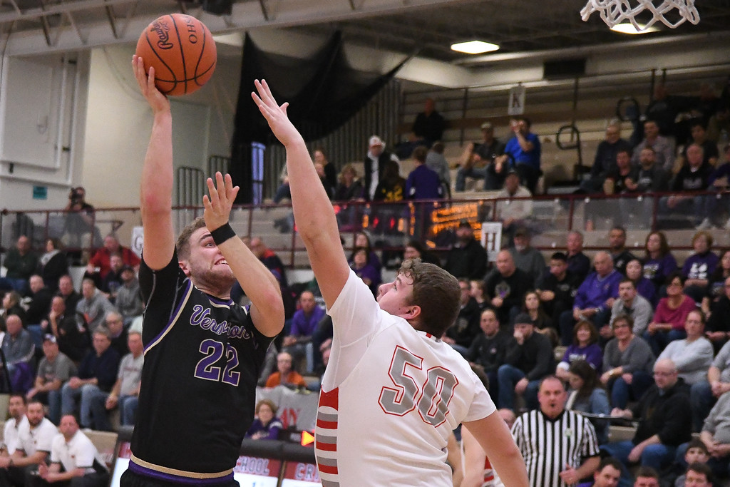 . Eric Bonzar�The Morning Journal<br> Vermilion\'s Ethan Habermehl shoots over Shelby forward Nick Amstutz, March 2, 2018.