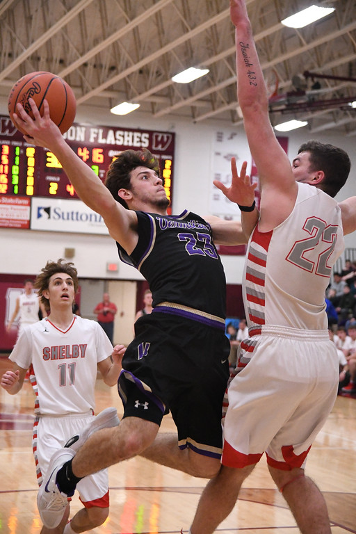 . Eric Bonzar�The Morning Journal<br> Vermilion\'s Joby Pfeil soars to the basket as he\'s defended by Shelby forward Carter Brooks, March 2, 2018.