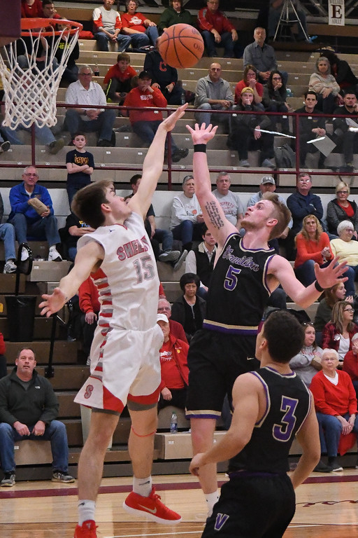 . Eric Bonzar�The Morning Journal<br> Vermilion\'s Seth Hurd drops a floater over Shelby guard Tanner Stephens, March 2, 2018.