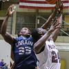 Eric Bonzar—The Morning Journal<br /> Lorain forward Naz Bohannon (33) and Maple Heights' Daray Menefield (24) fight for a rebound, Feb. 3, 2017.