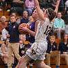 Eric Bonzar—The Morning Journal<br /> Avon's Karlee Clements drives to the hoop past Olmsted Falls guard Rachael Vance, March 3, 2017.
