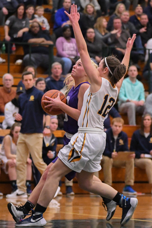 . Eric Bonzar�The Morning Journal Avon\'s Karlee Clements drives to the hoop past Olmsted Falls guard Rachael Vance, March 3, 2017.