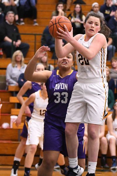 Eric Bonzar—The Morning Journal<br /> Olmsted Falls' Clare Kelly pulls down a defensive rebound over Avon's Shaylynn Davidson, March 3, 2017.