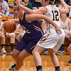 Eric Bonzar—The Morning Journal<br /> Avon's Juliann Walker is called for the foul as she tries to drive the baseline around Olmsted Falls guard Rachael Vance, March 3, 2017.