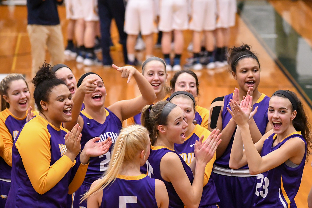 . Eric Bonzar�The Morning Journal Avon girls get rowdy before the start of their game against Olmsted Falls, March 3, 2017.