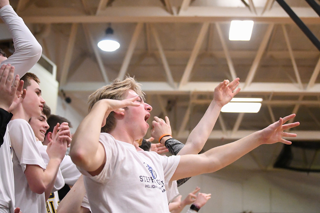 ". Eric Bonzar�The Morning Journal An Olmsted Falls student launches an ""air-row\"" after a bucket by his school\'s team, March 3, 2017."