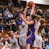 Eric Bonzar—The Morning Journal<br /> Olmsted Falls' Clare Kelly (20) pulls down a defensive rebound, March 3, 2017.