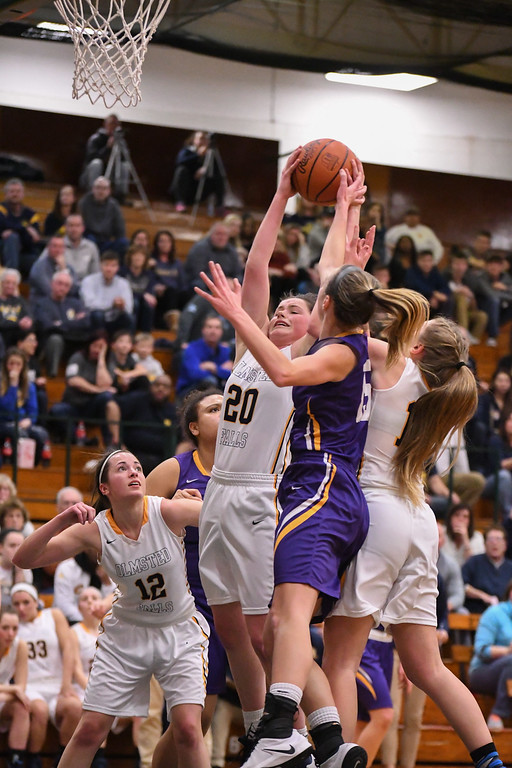 . Eric Bonzar�The Morning Journal Olmsted Falls\' Clare Kelly (20) pulls down a defensive rebound, March 3, 2017.