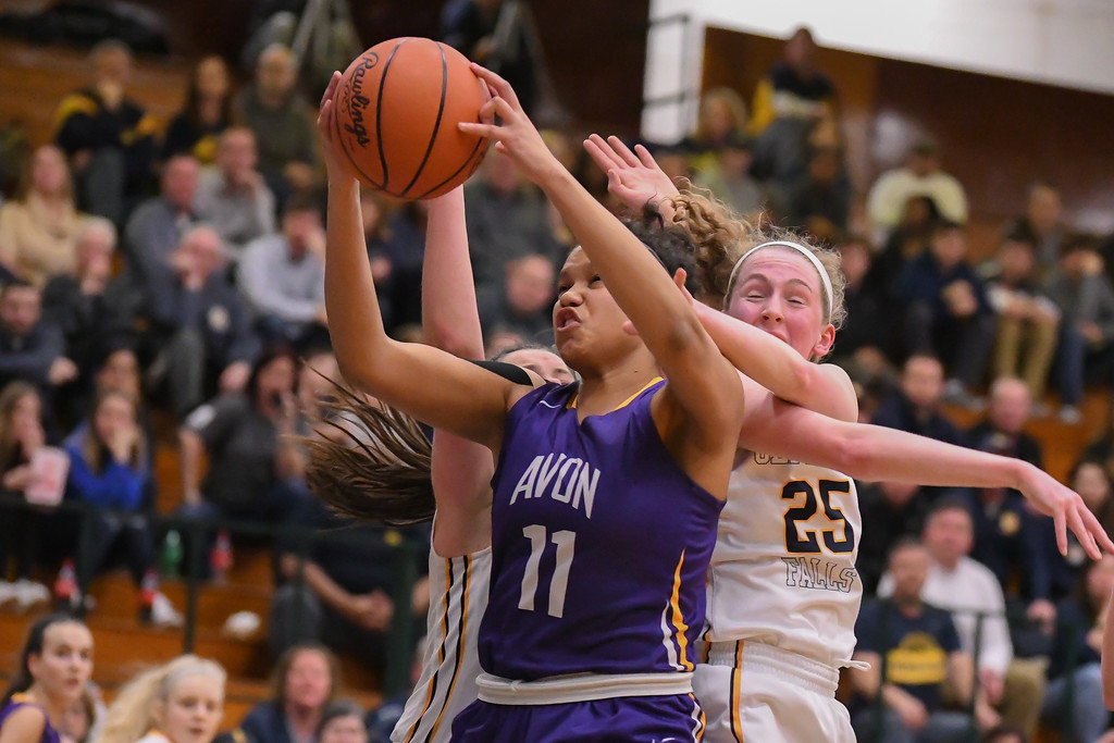. Eric Bonzar�The Morning Journal Avon\'s Amari Davidson snags an offensive rebound from Olmsted Falls\' Sarah Balfour (25), March 3, 2017.