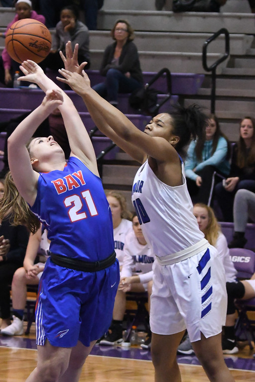 . Eric Bonzar�The Morning Journal<br> Bay\'s Haley Andrejcak and Gilmour\'s Alexys Foster fight for a rebound.