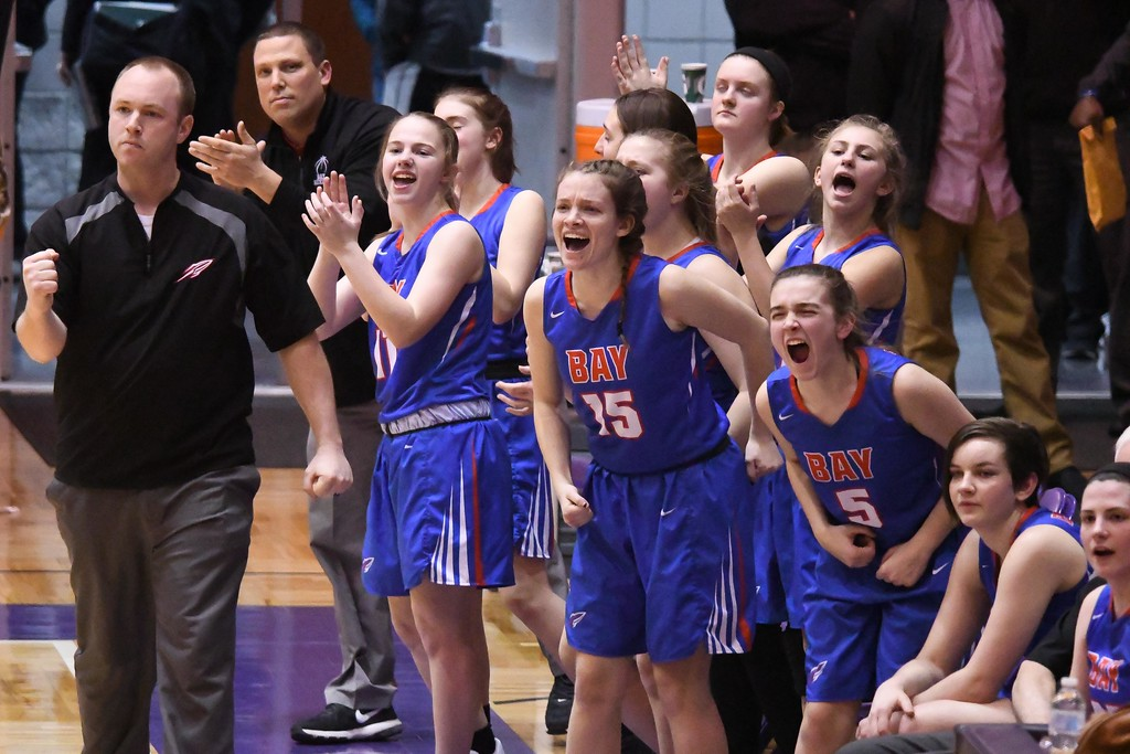 . Eric Bonzar�The Morning Journal<br> The Bay bench celebrates an and-one call after temmate Halle Orr is fouled by Gilmour\'s Emma Gurley as she drives to to the hoop and scores.