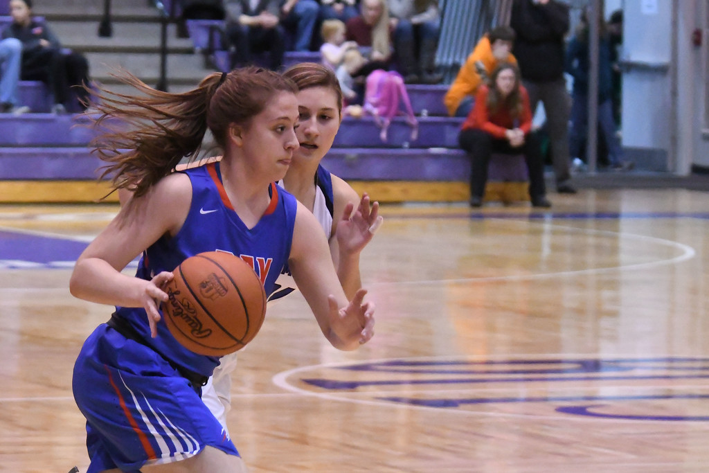 . Eric Bonzar�The Morning Journal<br> Bay\'s Haley Andrejcak dribbles past half court as she is defended by Gilmour\'s Maddie Puletti.