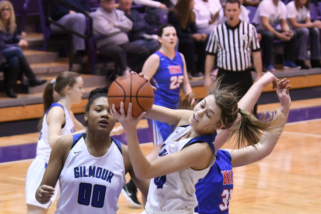 . Eric Bonzar�The Morning Journal<br> Gilmour\'s Athena Hocevar pulls down a defensive rebound.