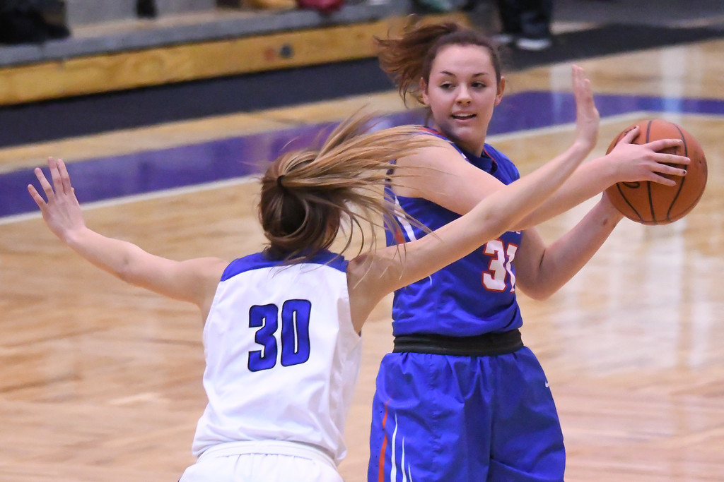 . Eric Bonzar�The Morning Journal<br> Bay\'s Maeve Johnston looks to move the ball up court past Gilmour defender Athena Hocevar.