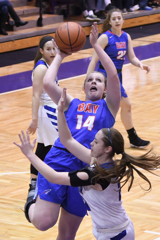 . Eric Bonzar�The Morning Journal<br> Bay\'s Halle Orr is fouled by Gilmour\'s Emma Gurley as she drives to to the hoop and scores.