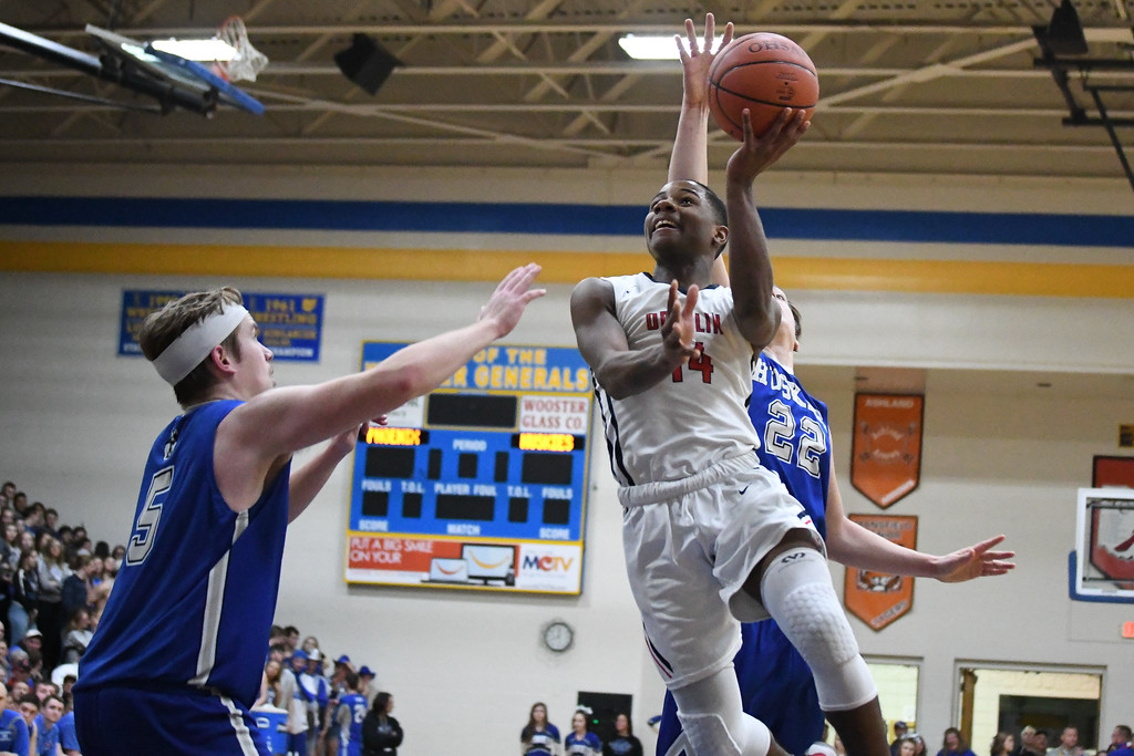 . Eric Bonzar�The Morning Journal Oberlin\'s Devin Yarber (14) drives to the hoop, March 10, 2017.