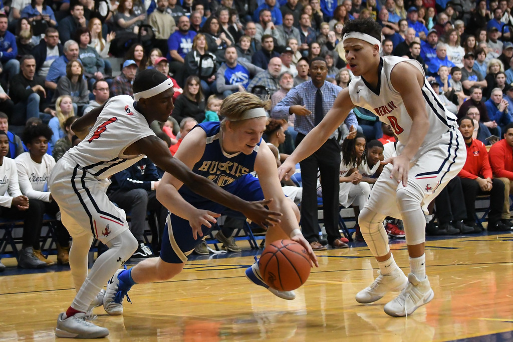 . Eric Bonzar�The Morning Journal Northwestern\'s Parker Smith (10) fights for a loose ball from Oberlin\'s Kurt Russell Jr. (4), March 10, 2017.