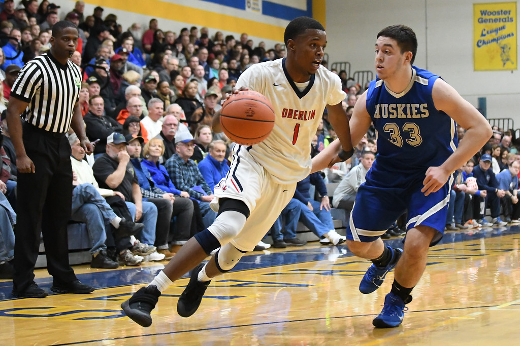 . Eric Bonzar�The Morning Journal Oberlin guard Justin Smith (1) drives baseline around the defense of Northwestern forward Jared Alberts (33), March 10, 2017.