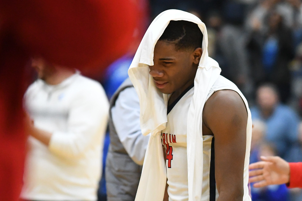 . Eric Bonzar�The Morning Journal Oberlin junior Devin Yarber walks off the court after a 66-51 loss to the Northwestern Huskies, in D-III Wooster District Finals, March 10, 2017.