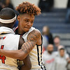 Eric Bonzar—The Morning Journal<br /> Oberlin's Caleb Hughley hugs fellow senior Kurt Russell Jr. (4) after a 66-51 loss to the Northwestern Huskies, in D-III Wooster District Finals, March 10, 2017.