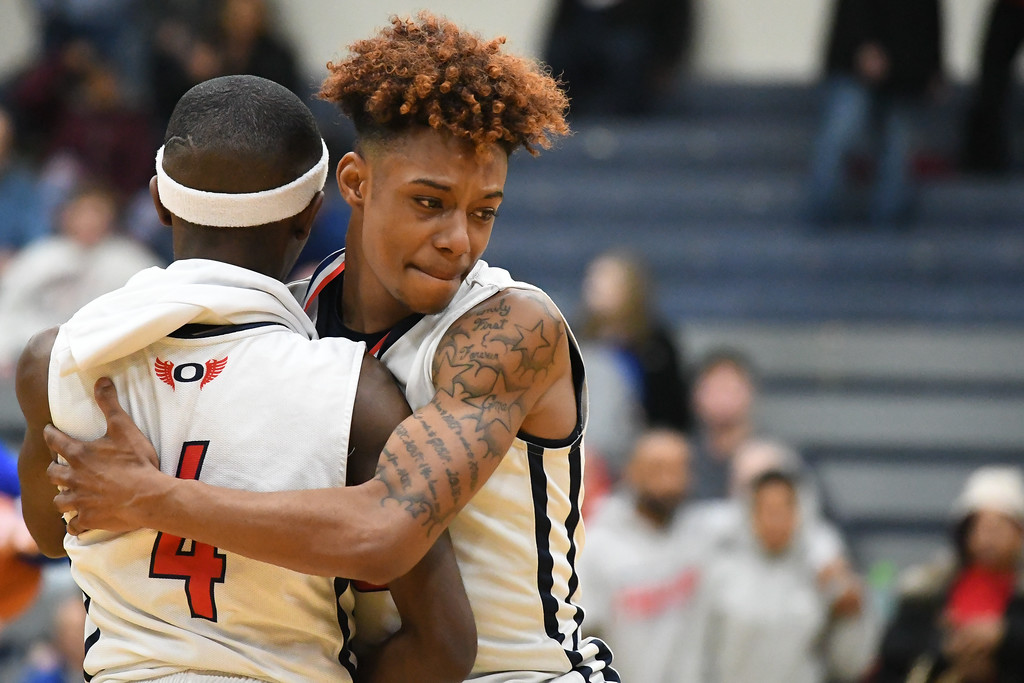 . Eric Bonzar�The Morning Journal Oberlin\'s Caleb Hughley hugs fellow senior Kurt Russell Jr. (4) after a 66-51 loss to the Northwestern Huskies, in D-III Wooster District Finals, March 10, 2017.