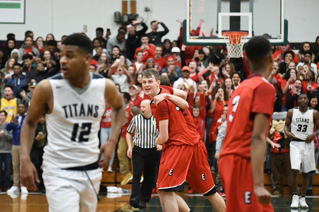 . Eric Bonzar�The Morning Journal The 2-seeded Elyria Pioneers claimed the OHSAA D-I District Championship trophy after knocking off the top-seeded Lorain Titans, 55-47, at Elyria Catholic High School, March 11, 2017.