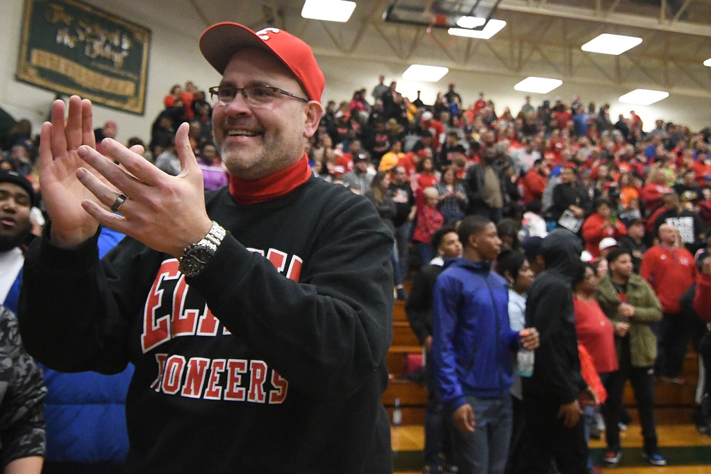 . Eric Bonzar�The Morning Journal Elyria City Schools Superintendent Dr. Thomas Jama applauds the Pioneers on their 55-47 win over the Lorain Titans, March 11, 2017.