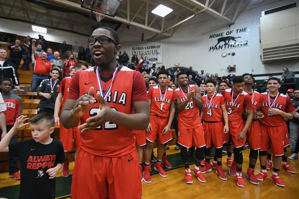 . Eric Bonzar�The Morning Journal Elyria senior Antonio Blanton (22) applauds his team\'s OHSAA D-I District Championship after knocking off top-seeded Lorain, 55-47, March 11, 2017.
