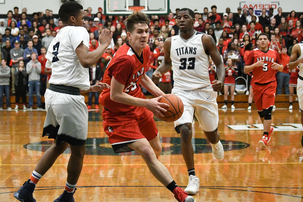 . Eric Bonzar�The Morning Journal Elyria\'s Josh Lotko drives to the basket past Lorain\'s Shayne Smith (3), March 11, 2017.