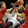 Eric Bonzar—The Morning Journal<br /> St. John's Vincent Williams Jr. (32) is fouled on his way to the basket by Elyria's Justin Koepp (35), March 15, 2017.