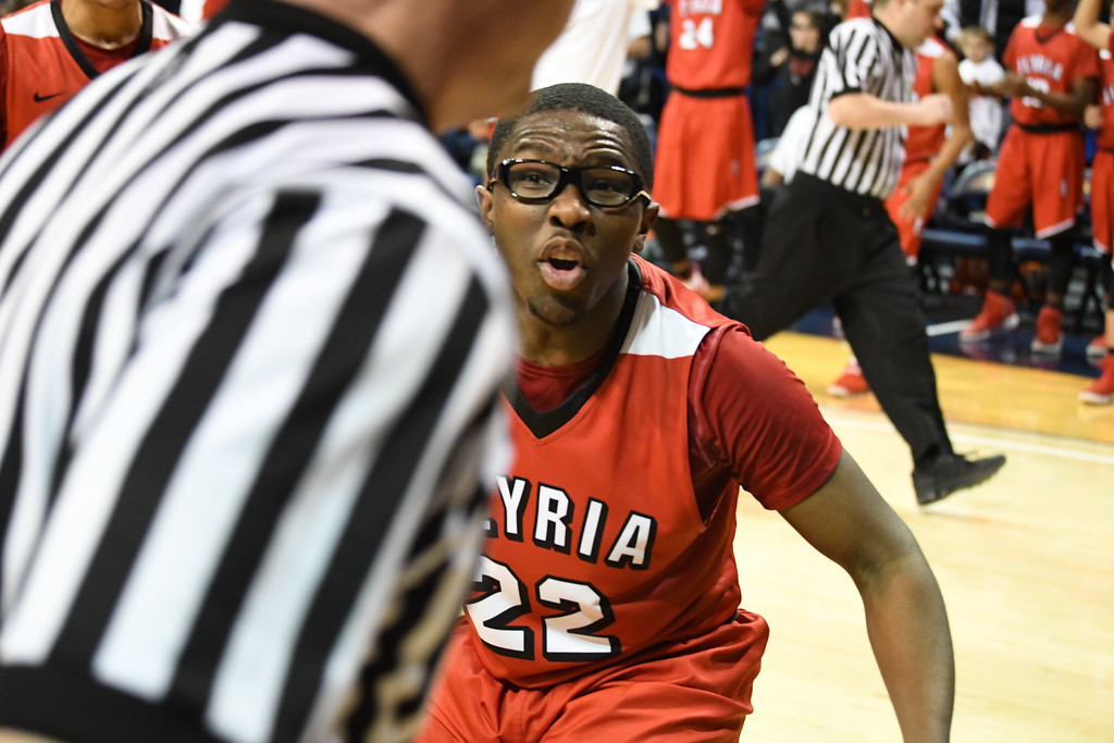 . Eric Bonzar�The Morning Journal Elyria senior Antonio Blanton (22) looks for a foul call as the clock hits zero, in the Pioneers 48-47 loss to the St. John\'s Jesuit Titans, March 15, 2017.