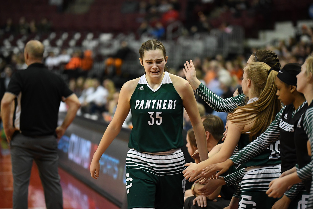 . Eric Bonzar�The Morning Journal<br> Elyria Catholic senior Megan Scheibelhut (35) chokes back tears as she checks out of the game with three minutes left.