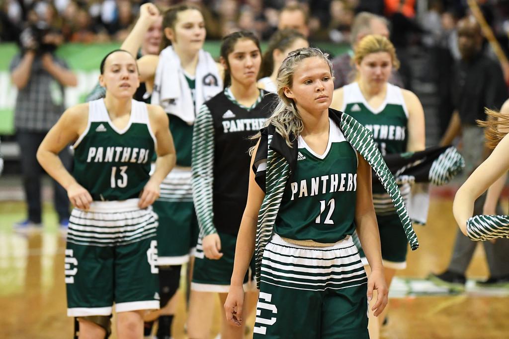 . Eric Bonzar�The Morning Journal<br> Elyria Catholic junior guard Faith Williams and her team walk off the court after ending their season 22-6 after a 63-47 loss to the Versailles Tigers, March 15, 2018.
