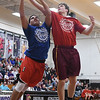 Eric Bonzar—The Morning Journal<br /> Elyria's Dez Brown, left, and Avon Lake's David Marsh battle for a rebound during the Legeza Cage Classic All-Stars All-Star game, March 26, 2017.