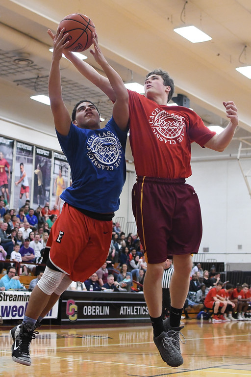 . Eric Bonzar�The Morning Journal Elyria\'s Dez Brown, left, and Avon Lake\'s David Marsh battle for a rebound during the Legeza Cage Classic All-Stars All-Star game, March 26, 2017.