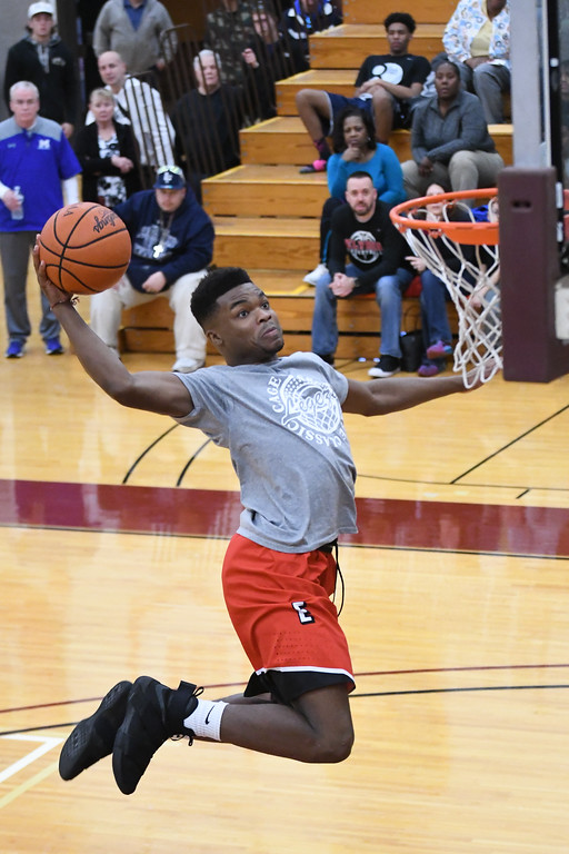 . Eric Bonzar�The Morning Journal Elyria\'s Deviian Williams soars to the rim for a dunk during the Legeza Cage Classic All-Stars dunk contest, March 26, 2017. Williams won the contest.