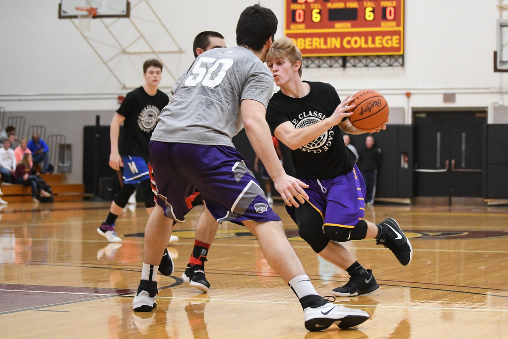 . Eric Bonzar�The Morning Journal Avon\'s Ryan Maloy drives to the paint past the defense of Keystone\'s Jeremy Gerhardinger (50) during the Legeza Cage Classic All-Stars Rising Stars game, March 26, 2017.