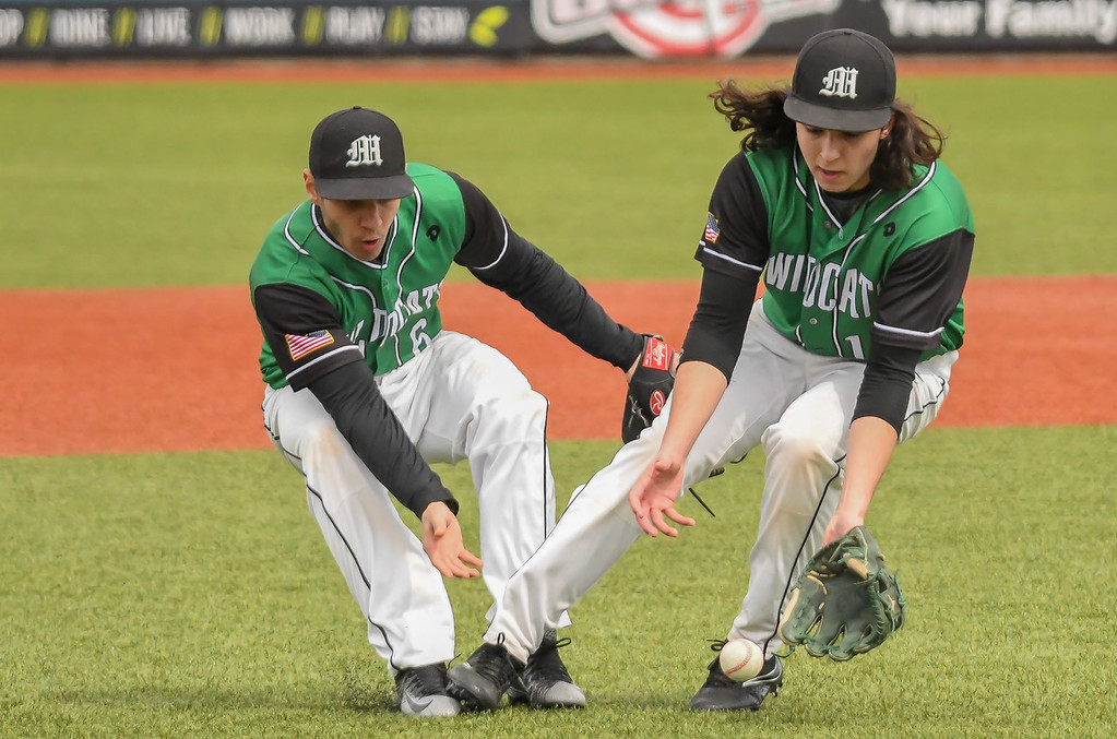 . Eric Bonzar�The Morning Journal<br> Mayfield third baseman Donte Regalbuto (6) and pitcher Dominic DiPippo collide as they field a dribbler.