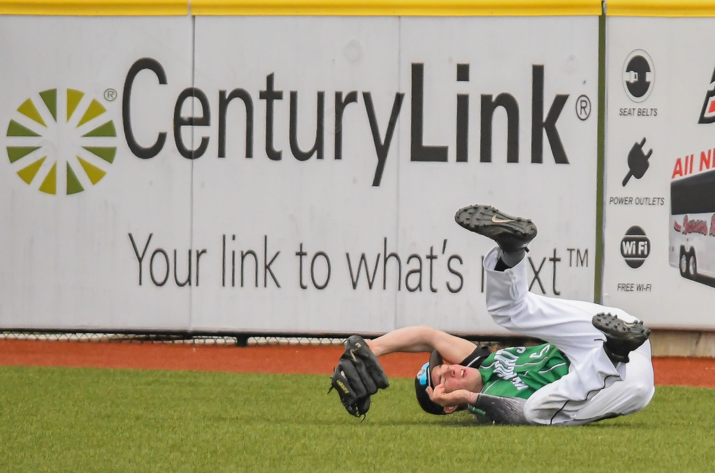 . Eric Bonzar�The Morning Journal<br> Mayfield right fielder Chuck Heil makes an acrobatic catch.