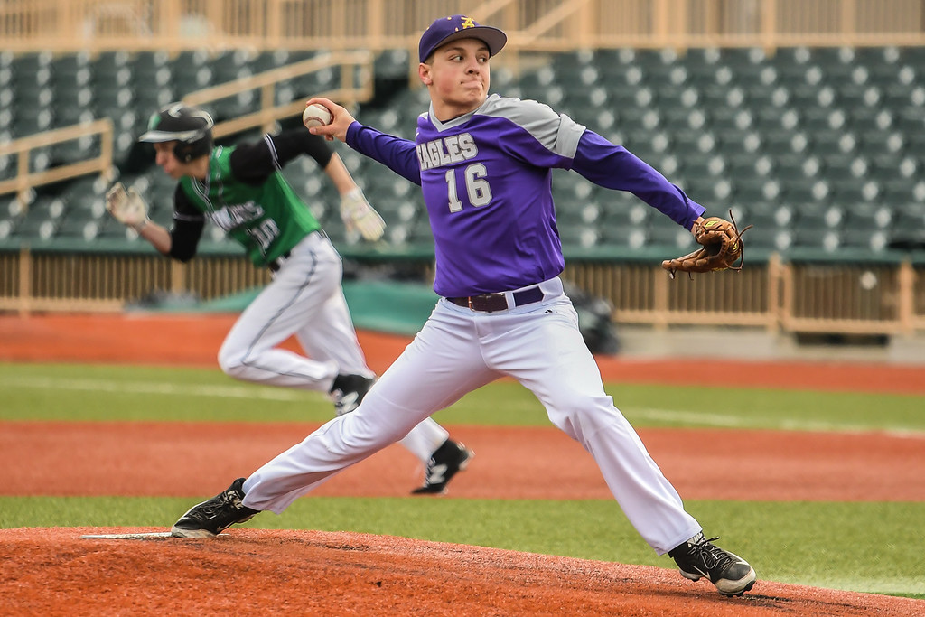 . Eric Bonzar�The Morning Journal<br> Mayfield\'s Jimmy Gaudio breaks for second base as Avon pitcher Josh Rattay delivers.
