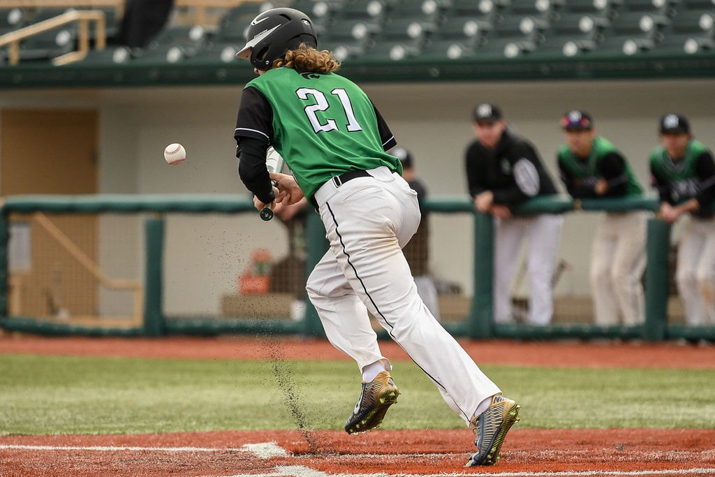 . Eric Bonzar�The Morning Journal<br> Mayfield\'s Samuel Guerrini lays down a bunt.