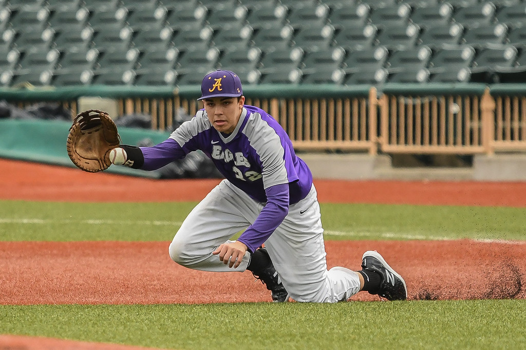 . Eric Bonzar�The Morning Journal<br> Avon first baseman Liam Ostrowski goes to one knee to field a shot in the gap.