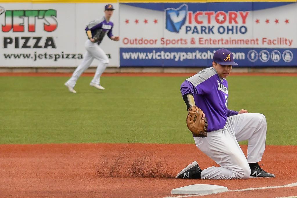 . Eric Bonzar�The Morning Journal<br> Avon first baseman Liam Ostrowski makes a backhanded grab.