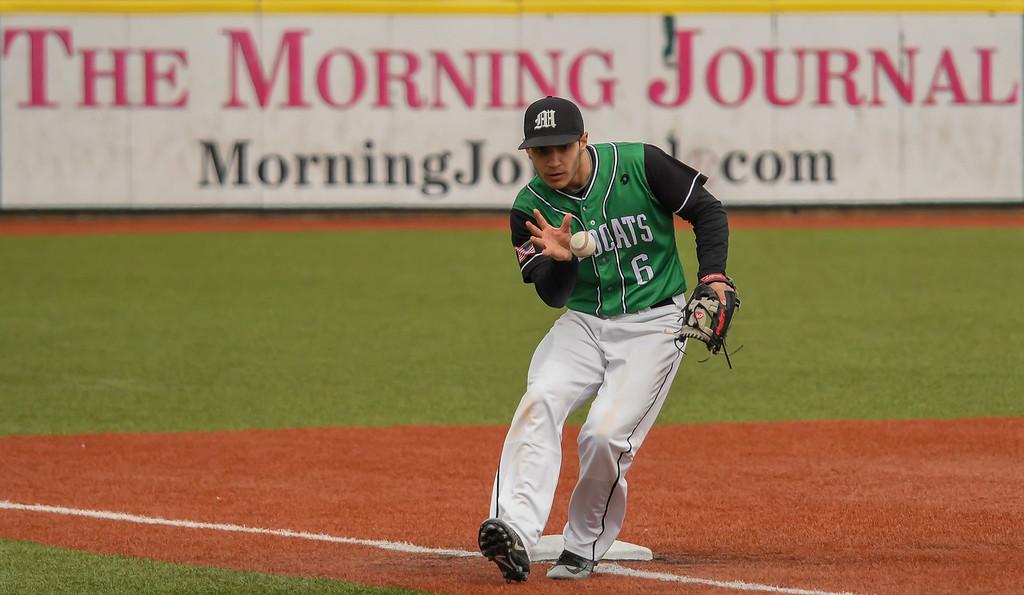 . Eric Bonzar�The Morning Journal<br> Mayfield third baseman Donte Regalbuto bare hands a foul ball.
