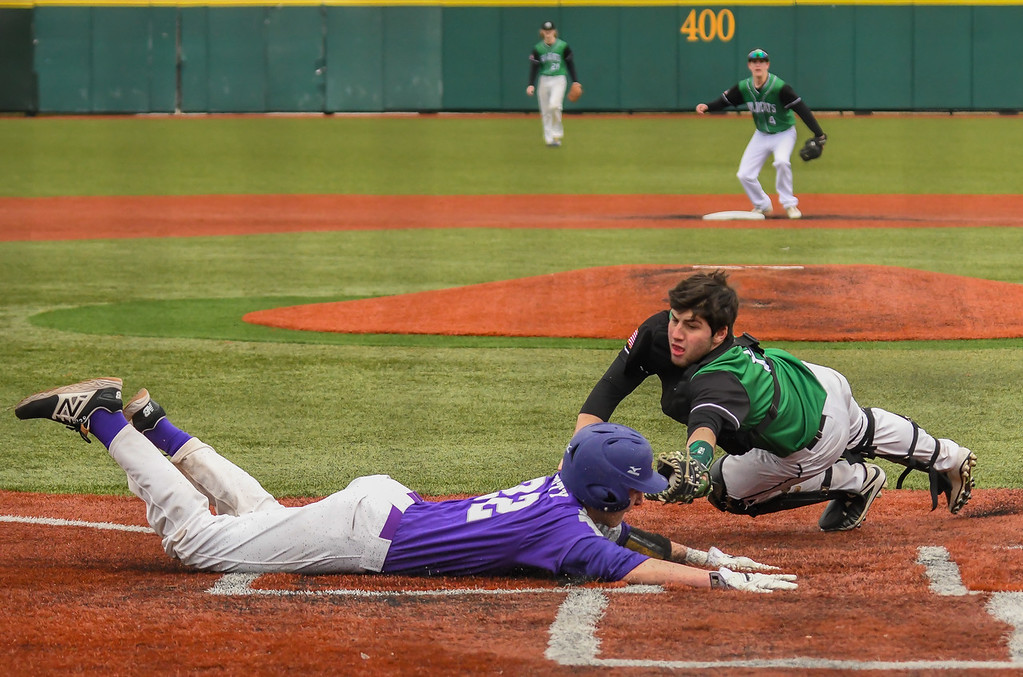 . Eric Bonzar�The Morning Journal<br> Avon\'s Cooper Docherty slides into home plate as he beats the tag of Mayfield catcher Grant Rice.