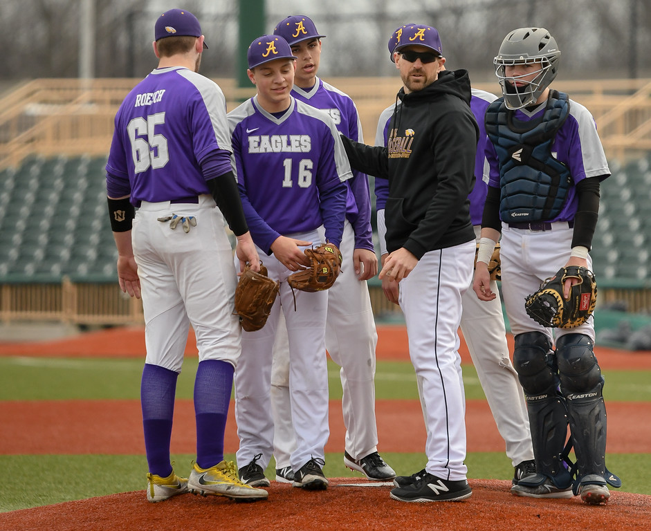 . Eric Bonzar�The Morning Journal<br> Avon pitcher Josh Rattay (16) checks out after Mayfield scores six unearned runs in a 2/3 inning of work.