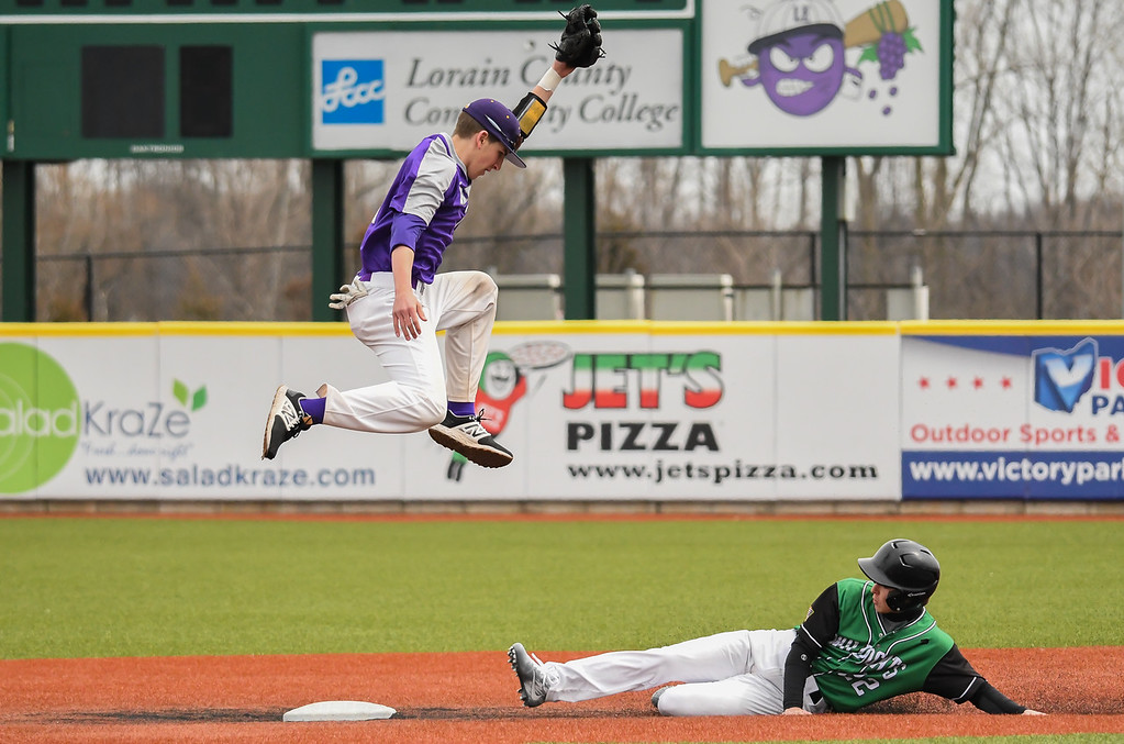 . Eric Bonzar�The Morning Journal<br> Mayfield\'s Cole Zak steals second as Avon shortstop Cooper Docherty cannot pull in an errant throw from catcher Tanner Egger.