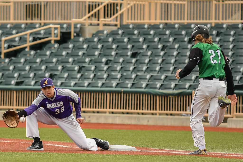 . Eric Bonzar�The Morning Journal<br> Avon first baseman Liam Ostrowski goes to one knee to field a bunt from Mayfield\'s Samuel Guerrini.